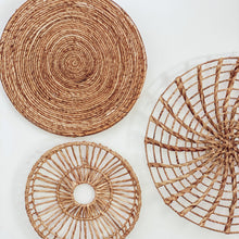Load image into Gallery viewer, A collection of round baskets wall art woven with authentic water hyacinth reeds.