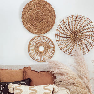 A collection of round baskets wall art woven with authentic water hyacinth reeds.