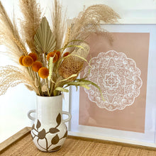 Load image into Gallery viewer, 2-handled ceramic urn shaped vase displaying dried floral arrangement next to a boho mandala print