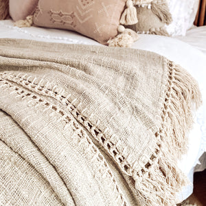 Natural coloured eco-friendly cotton throw trimmed with a crocheted natural cotton blanket stitch and end fringing.
