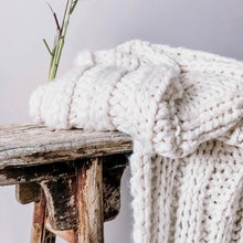 Load image into Gallery viewer, Hamptons-inspired, comfy, coastal, luxurious, super chunky hand-knit throw that is soft and cuddly. Made from an acrylic/wool blend in a natural/white colour.
