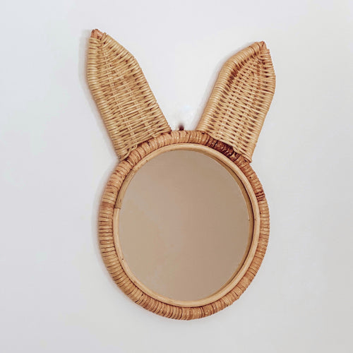 Natural coloured round rattan and wicker mirror in a cute bunny ears design.