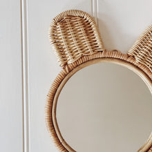Load image into Gallery viewer, Close up of natural coloured round rattan and wicker mirror in a cute bear ears design.