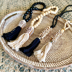 Beaded shell necklace hangings perfect for adding some tribal/coastal luxe to your home décor. Handmade using small wooden beads strung with a selection of small shells and large cotton tassel.