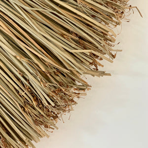 Close up of seagrass wall hanging to show the authentic nature of the product.