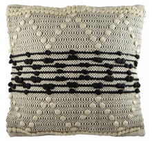 Load image into Gallery viewer, Square cushion featuring black stripes and white zig zag patterns in knotted detail on natural weave background