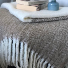 Load image into Gallery viewer, Brushed wool and acrylic throw rug in two-tone camel and white, finished with a chunky white rolled fringe at opposite ends