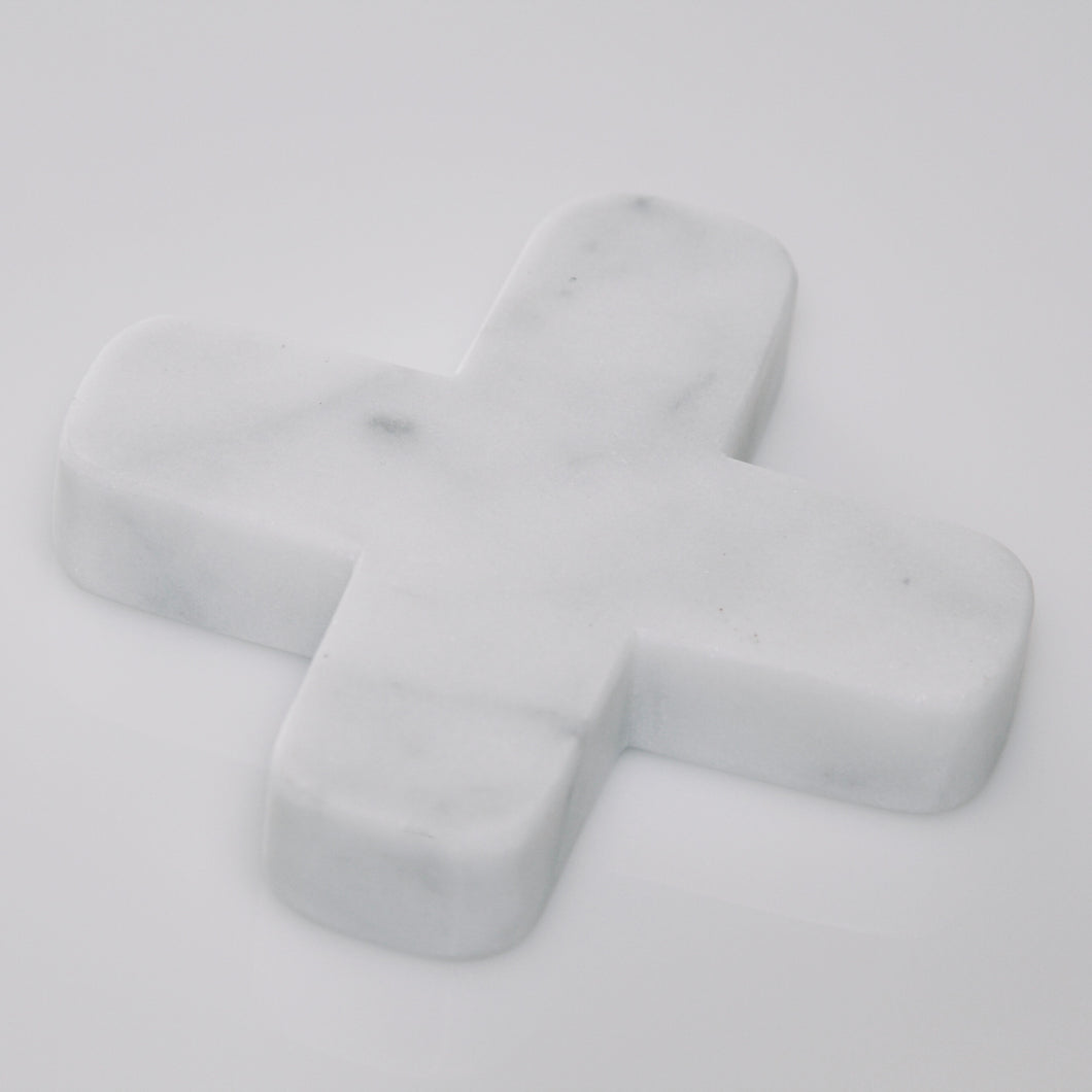 Little white decorative cross carved from marble-look stone with a unique combination of white and grey colours and natural veining.