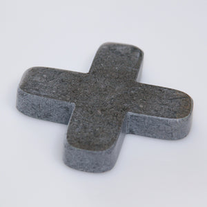 Little grey decorative cross carved from marble-look stone with a unique combination of grey colours and natural veining.