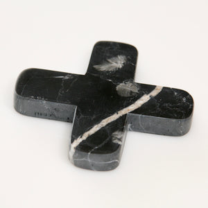 Little black decorative cross carved from marble-look stone with a unique combination of black and white colours and natural veining.
