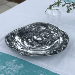 Round silver-plated shallow bowl set in a decorative rippled formation