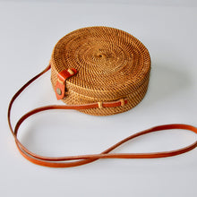 Load image into Gallery viewer, Round rattan ata crossbody handbag in natural colour with tan leather snap closure and long tan leather body strap