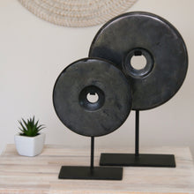 Load image into Gallery viewer, Solid round black marbled granite disc displayed on black single stem stand