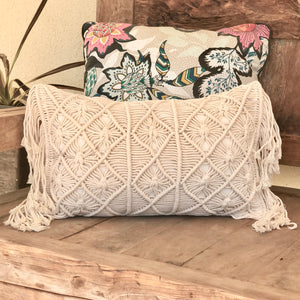 Macramé lumbar cushion intricately hand woven with 100% natural eco-friendly cotton and finished in a diamond pattern with soft side fringing on both short ends