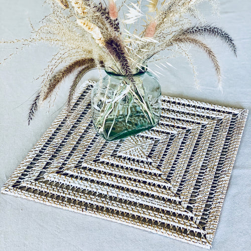 Square open weave natural rattan table centrepiece/placemat with whitewashed finish.