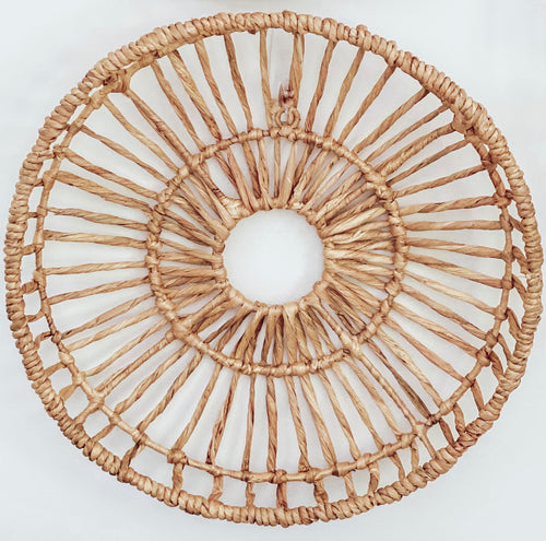 Round basket wall art woven with authentic water hyacinth reeds.