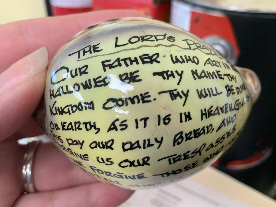 Lord's Prayer on cowrie shell