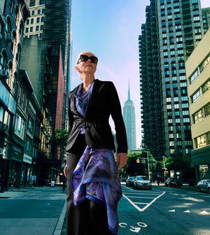 Supermodel and silver-haired international beauty, Yazmeenah models out signature piece, Iris. Italian made silk scarves in New York City's fifth ave.Yasmeenah is wearing 2 iris scarves to add a pop of color to her neutral color ensemble.  Women over 40 w