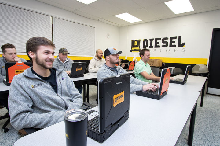 Students learning Diesel Laptops software in class