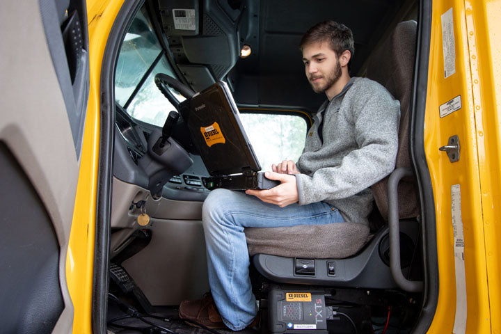 Student using IDC5 on an actual working truck