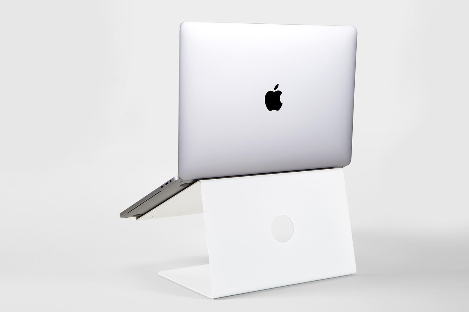 White stand for Apple Macbook