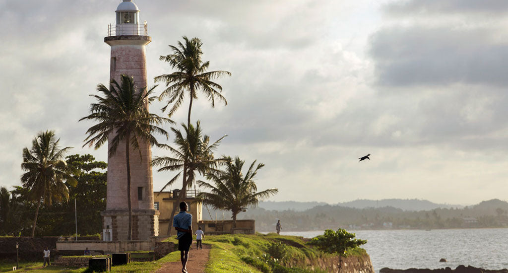 a man near a lighthouse galle sri lanka mischa blog