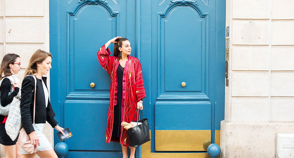 a woman standing in front of a blue door ;mischa blog