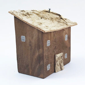 Wooden House with Bark Decoration