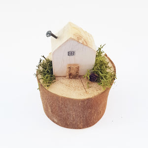 Miniature House on a Natural Log