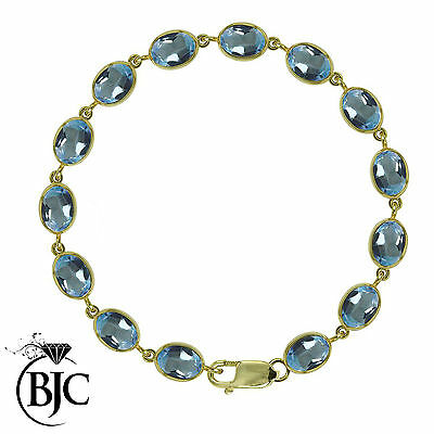 BJC® 9ct Yellow Gold Natural Blue Topaz 21.00ct Oval Gemstone Tennis Bracelet