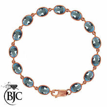 Load image into Gallery viewer, BJC® 9ct Rose Gold Natural Blue Topaz 21.00ct Oval Gemstone Tennis Bracelet