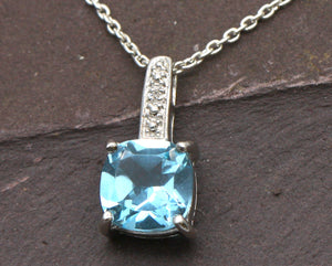 BJC® Sterling Silver Blue Topaz & Diamond Pendant & Optional Silver Necklace SP2