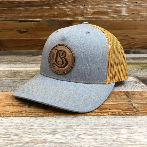 SB Co. Stamped Leather Circle Patch Trucker Hat - Heather Grey/Gold