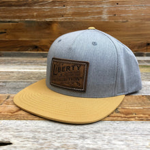 Load image into Gallery viewer, Stamped Leather Liberty Patch Flat Bill Hat - Heather Grey/Gold