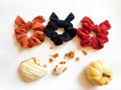 Pumpkin spice showcase corduroy velvet scrunchies with bows flat lay pumpkin spice pumpkin cider fall night