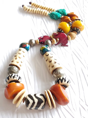 Carved Bone and Horn, Copal Amber Resin Batik Bone Lampwork Glass Elephant Casual Statement Necklace, The Juke Joint