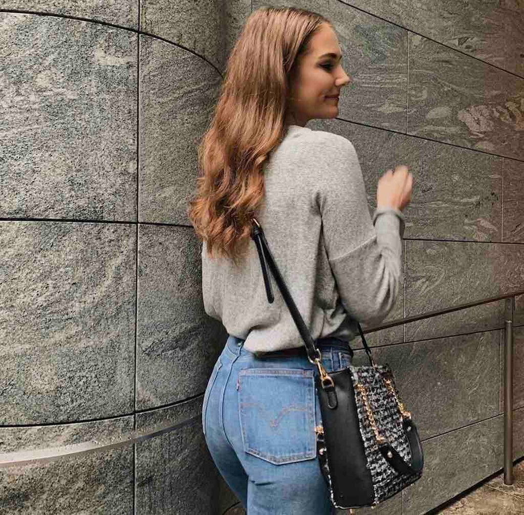 laura pairing her kinds of grace vegan handbag with high waisted jeans and a baggy top