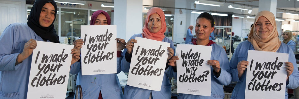 garment workers holding fashion revolution 'i made your clothes' signs