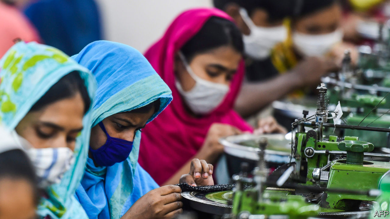 Garment workers wearing face masks, ethical fashion in a pandemic