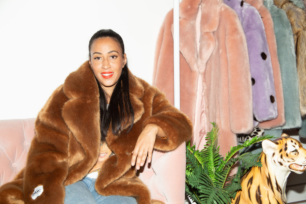 jakke founder wearing faux fur vegan coat