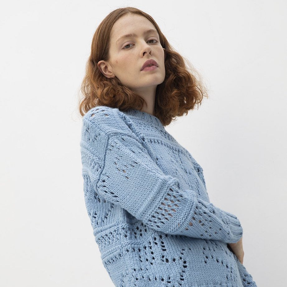 model wearing wool free vegan knitwear