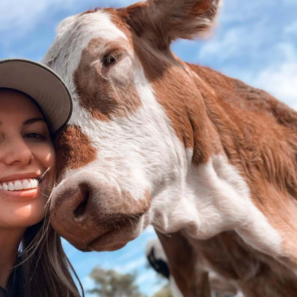 Shannon and a rescued cow