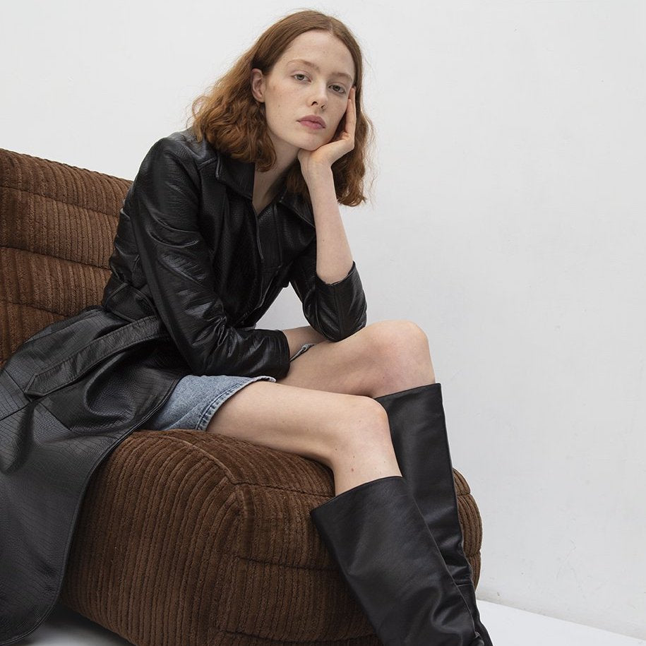 model wearing vegan leather coat and boots