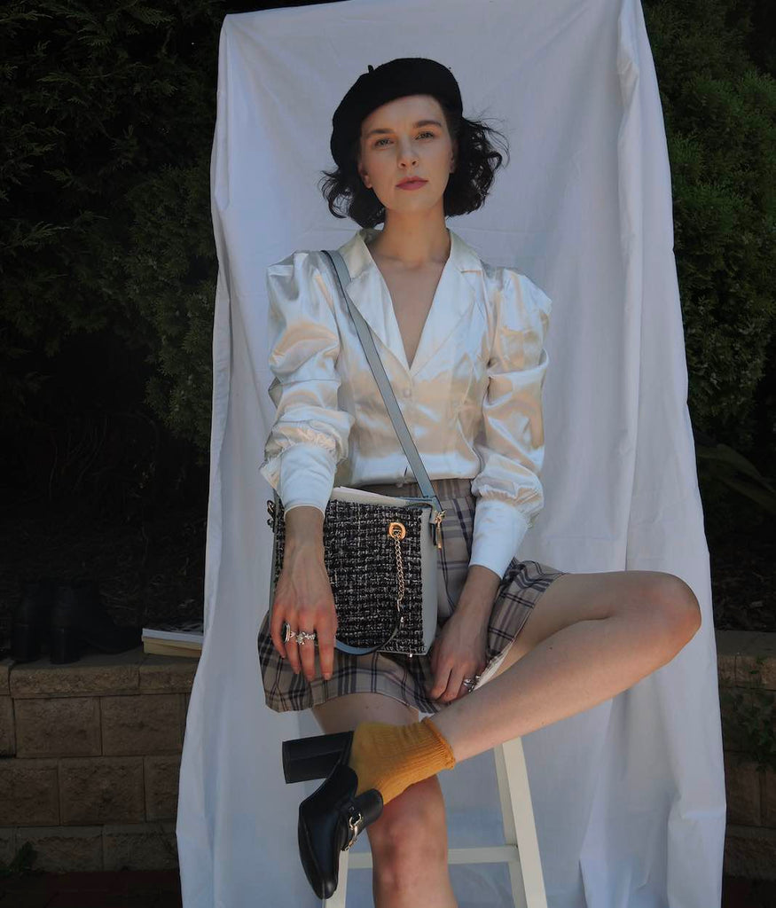 vegan cross body bag styled with beret and tweed skirt