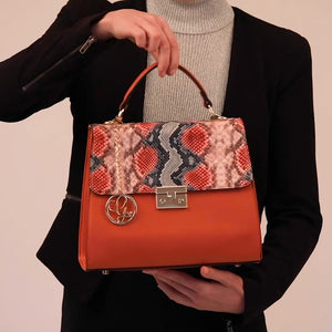 Load and play video in Gallery viewer, Orange Animal Print Vegan Bag
