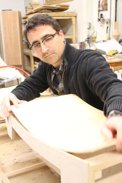 Vincent Leman building a piece of artisan furniture.