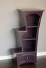 Stepped display bookcase in dark violet paint