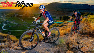 Lady pulling a child up a mountain in Utah using a TowWhee bungee connecting the bikes