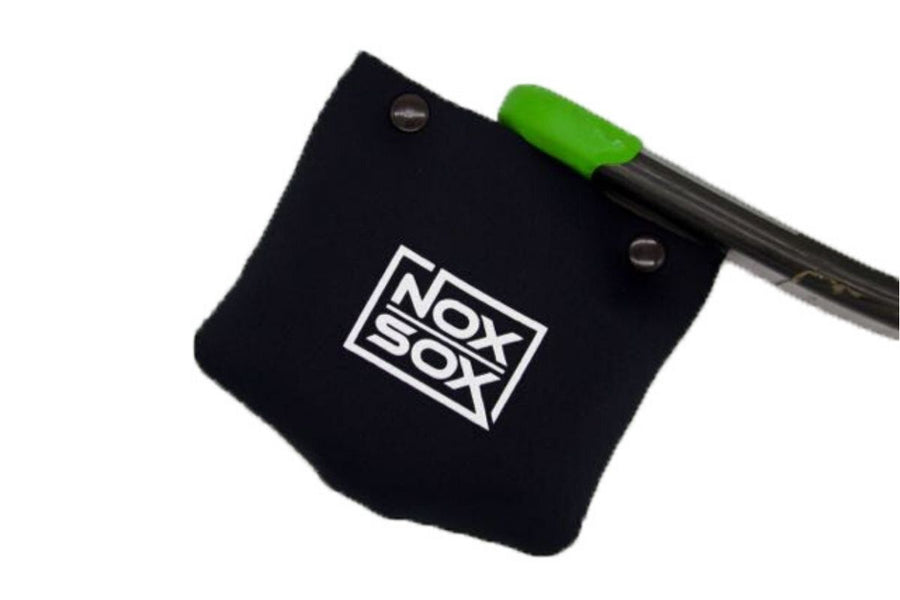 Nox Sox Large Pedal Cover sliding over a DMR Vault flat pedal