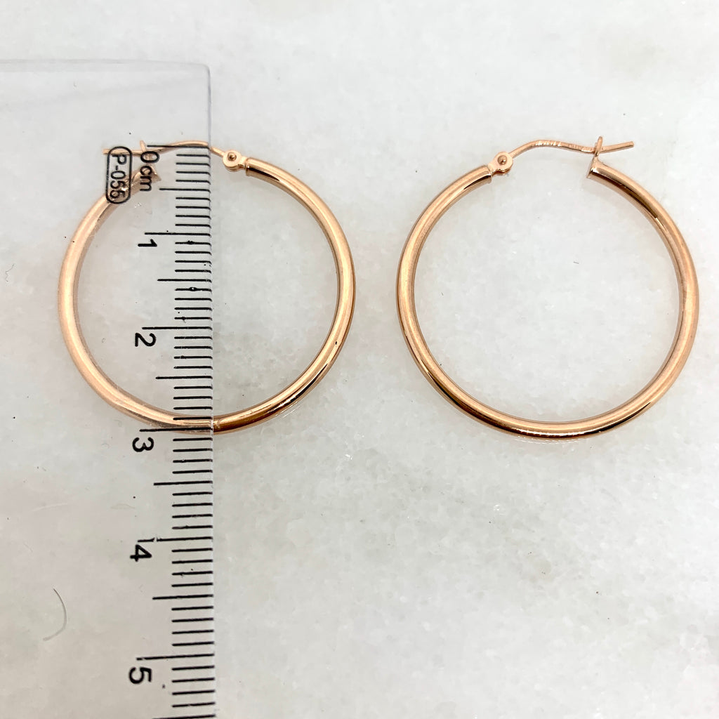 "10K Rose Gold 1.2"" Polished Hoop Earrings"